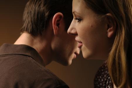 Woman whisper in ear man