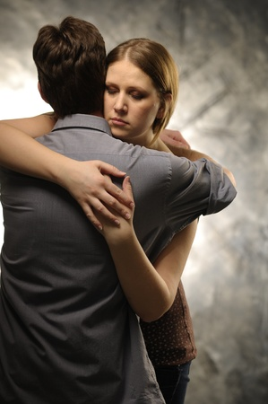 Couple in an embrace on an gray background photo