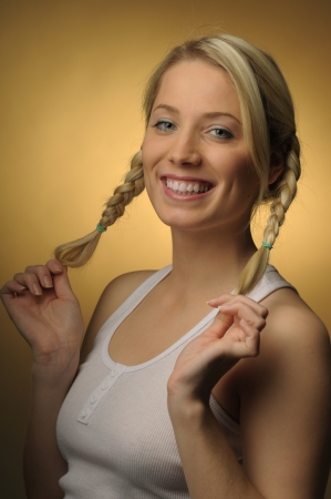 Picture of young woman pulling her braids photo