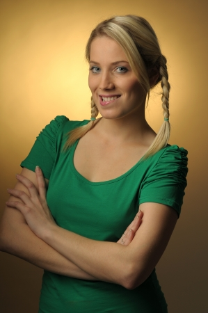 Young woman with blond braids photo