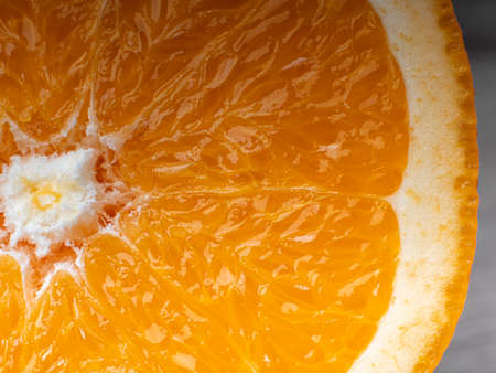 Macro photo of an orange slice in a cut. Concept of fresh juice and fruit
