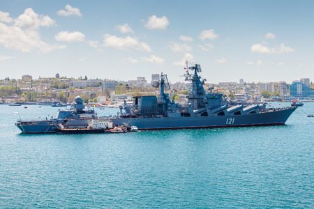 flagship: SEVASTOPOL, CRIMEA - MAY 9: Parade of the Russian warships celebrating in honor of 70th anniversary of Victory Day on May 9th, 2015 Russian Navy flagship cruiser Moskva in the Sevastopol Bay, Crimea Stock Photo