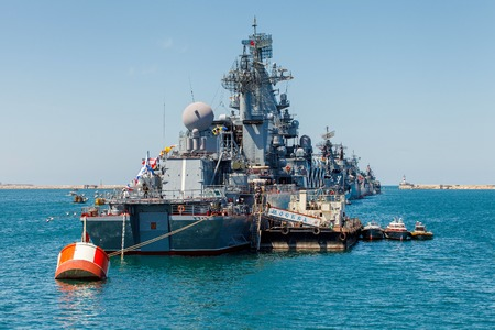 flagship: SEVASTOPOL CRIMEA MAY 9: Parade of the Russian warships celebrating in honor of 70th anniversary of Victory Day on May 9th 2015 Russian Navy flagship cruiser Moskva in the Sevastopol Bay Crimea