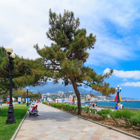 lenina: YALTA - MAY 17: People are walking along the Lenina Embankment with boutiques buildings on May 17, 2013 in Yalta, Ukraine.Russia.