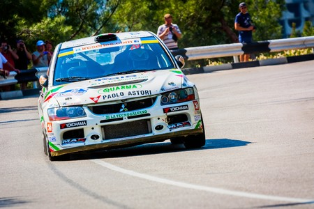 irc: YALTA, UKRAINE - SEPTEMBER 14: Marco Cavigioli drives his Mitsubshi Lancer Evolution.2012 Editorial