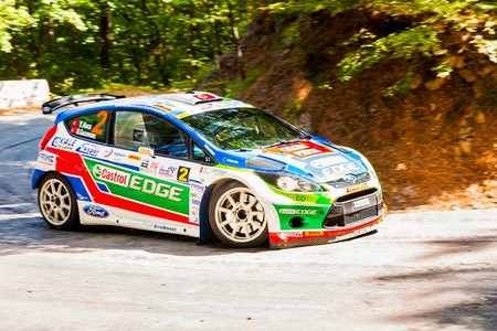 irc: YALTA, UKRAINE - SEPTEMBER 15: Yagiz Avci drives his Ford Fiesta.2012 Editorial