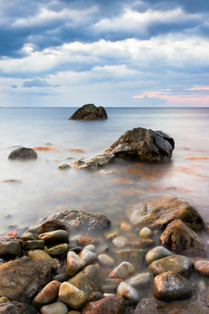 dramatics: Seascape. Seashore with misty water at sunset.