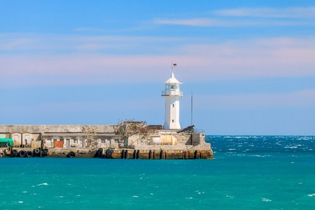 shipway: A view of the lighthouse in Yalta. Port. Crimea. Uraine