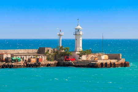 deck cannon: A view of the lighthouse in Yalta. Port. Crimea. Ukraine Stock Photo