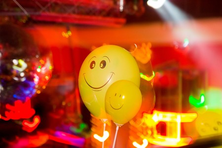 mirrorball: Party at Large Disco with special effects, balloon and fantastic laser show in smoke Stock Photo