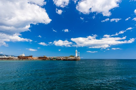 shipway: A view of the lighthouse in Yalta. Yalta. Port. Crimea