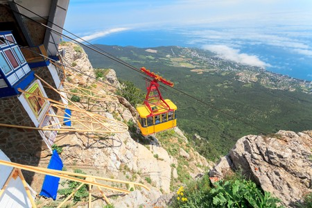 longest: MISHOR, CRIMEA, UKRAINE - MAY 12. People travel by rope way cab on top of Ai-Petri Mountain on May 12, 2013 in Mishor, Ukraine.Russia. This road has one of the longest unsupported span in Europe.