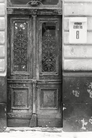 decrepitude: An entrance, st. Chopin Polish composer. in center of Lviv, culture city. Ukraine. Black and white