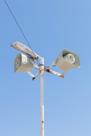 Many loudspeakers on blue sky. Information speak