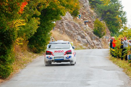 irc: YALTA, UKRAINE - SEPTEMBER 14. Nicholas Chmykh drives his Subaru Impreza during the WOG Yalta Rally Fest 2013. 2 day. on September 14, 2013 in Yalta, Ukraine. Editorial