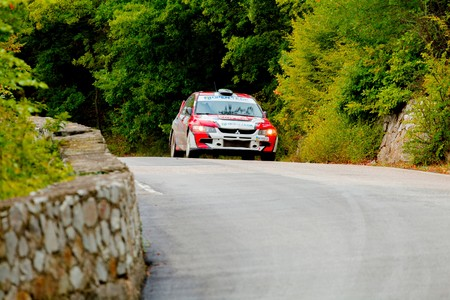 irc: YALTA, UKRAINE - SEPTEMBER 14. Yuri Kochmar drives his Mitsubishi Lancer during the WOG Yalta Rally Fest 2013. 2 day. on September 14, 2013 in Yalta, Ukraine. Editorial