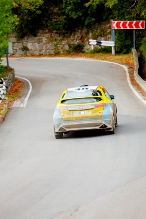 irc: YALTA, UKRAINE - SEPTEMBER 14. Vladimir Kondratenko drives his Honda Civic during the WOG Yalta Rally Fest 2013. 2 day. on September 14, 2013 in Yalta, Ukraine. Editorial
