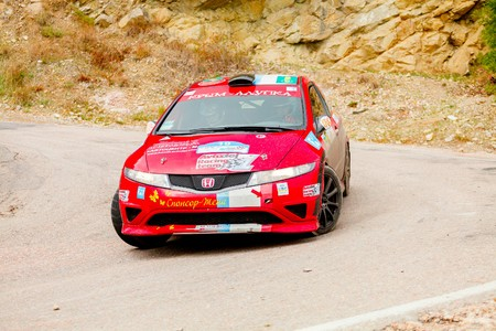 irc: YALTA, UKRAINE - SEPTEMBER 14. Alexey Panov drives his Honda Civic during the WOG Yalta Rally Fest 2013. 2 day. on September 14, 2013 in Yalta, Ukraine.