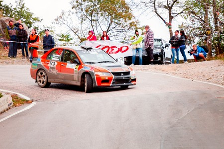 irc: YALTA, UKRAINE - SEPTEMBER 14. Vladimir Petrenko drives his Mitsubishi Lancer during the WOG Yalta Rally Fest 2013. 2 day. on September 14, 2013 in Yalta, Ukraine.