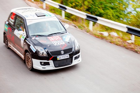 irc: YALTA, UKRAINE - SEPTEMBER 14. Alex Saifudinov drives his Suzuki Swift during the WOG Yalta Rally Fest 2013. 2 day. on September 14, 2013 in Yalta, Ukraine.