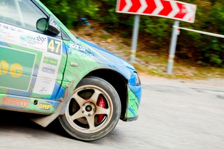 irc: YALTA, UKRAINE - SEPTEMBER 14. Evgeny Fomenko drives his Mitsubishi Lancer during the WOG Yalta Rally Fest 2013. 2 day. on September 14, 2013 in Yalta, Ukraine.