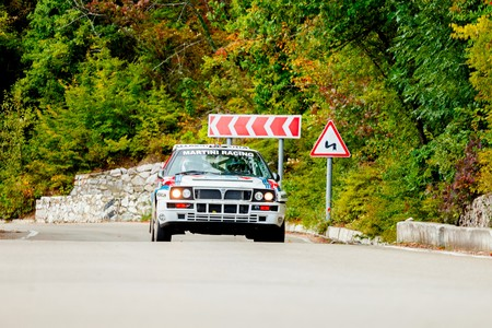 irc: YALTA, UKRAINE - SEPTEMBER 14. Sergey Chekan drives his Lancia Delta during the WOG Yalta Rally Fest 2013. 2 day. on September 14, 2013 in Yalta, Ukraine. Editorial