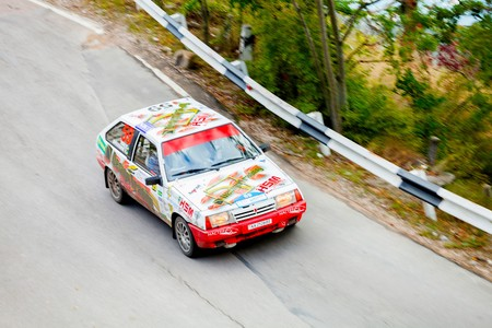 irc: YALTA, UKRAINE - SEPTEMBER 14. Vladimir Apostolyuk drives his VAZ 2108 during the WOG Yalta Rally Fest 2013. 2 day. on September 14, 2013 in Yalta, Ukraine.
