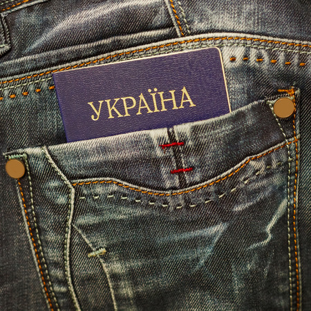 customs official: Ukrainian passport in jeans pocket close up. Stock Photo