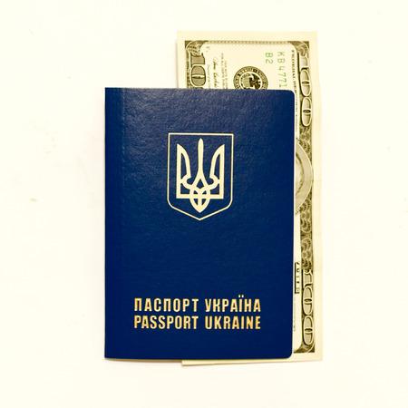 whine: Ukrainian passport and cash on whine close up. Stock Photo