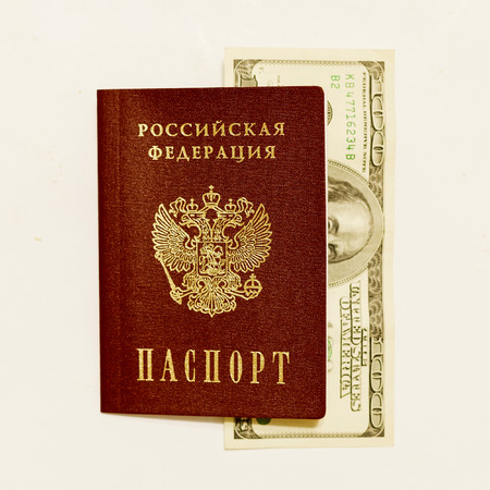 whine: Russian passport and cash on whine close up. Stock Photo