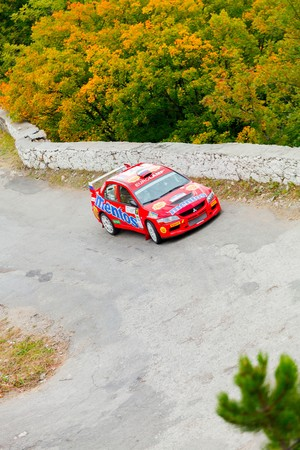 irc: YALTA, UKRAINE - SEPTEMBER 14. Dmitry Tahirov drives his Mitsubishi Lancer during the WOG Yalta Rally Fest 2013. 2 day. on September 14, 2013 in Yalta, Ukraine.