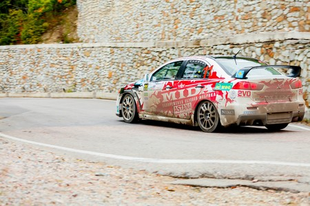 irc: YALTA, UKRAINE - SEPTEMBER 14. Anton Kuzmenko drives his Mitsubishi Lancer during the WOG Yalta Rally Fest 2013. 2 day. on September 14, 2013 in Yalta, Ukraine. Editorial