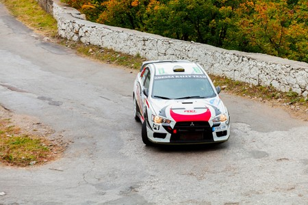 irc: YALTA, UKRAINE - SEPTEMBER 14. Vitaliy Pushkar drives his Mitsubishi Lancer during the WOG Yalta Rally Fest 2013. 2 day. on September 14, 2013 in Yalta, Ukraine.