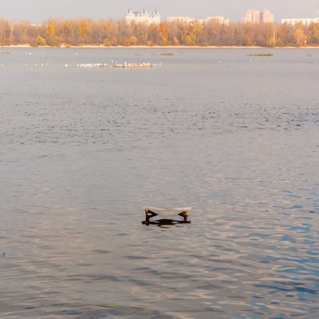 dnepr: Stool in the Dnepr River with views of the city. Fishing Spot. Kiev. Ukraine