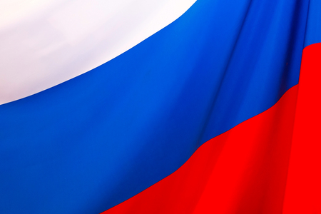 russian flag: Russian flag blowing in the wind. tricolor Stock Photo