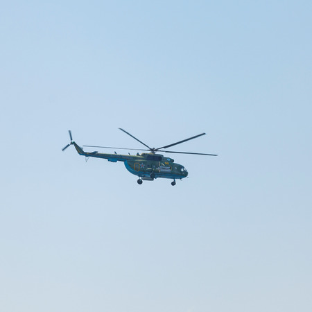 helicopter pilot: Crimea - 26 July 2015: parade in honor of the Day Russian Navy in Sevastopol. Flight MI-8 helicopter over the bay of the city