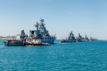 winning stock: SEVASTOPOL, CRIMEA - MAY 9: Parade of the Russian warships celebrating in honor of 70th anniversary of Victory Day on May 9th, 2015. Russian Navy fleet in the Sevastopol Bay, Crimea. Russia. Ukraine Editorial