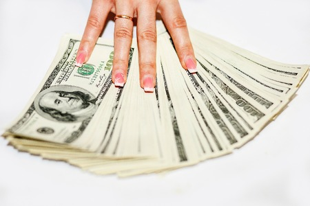 The money is in womens hand. Hand with money, banknotes in hand, counting banknotes. Stock Photo