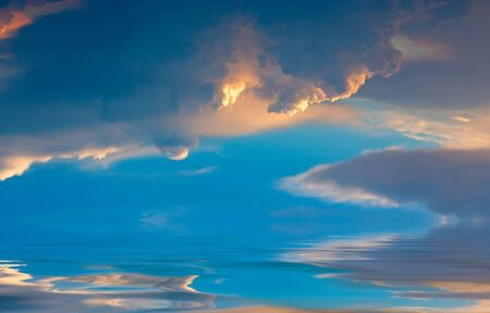 Beautiful Cumulus clouds over the sea at sunset. Natural composition.