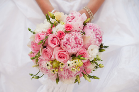 wedding accessories: Bride with bouquet, closeup