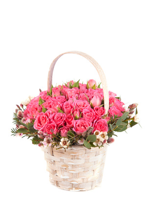 rose coloured: beautiful bouquet of pink roses in basket isolated on white background