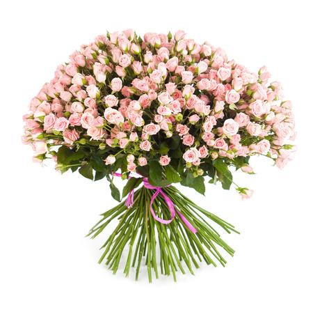 mazzo di fiori: Grande bouquet di fiori dal rosa brillante rose isolato su sfondo bianco. Avvicinamento. Archivio Fotografico