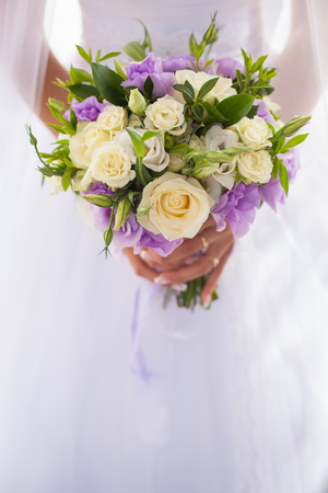 Bride with wedding bouquet, closeup Stock Photo