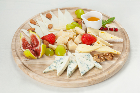 caciocavallo: Various types of cheese on a cheese platter Stock Photo