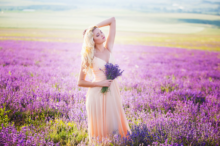 Portrait of a beautiful girl on the lavender field.