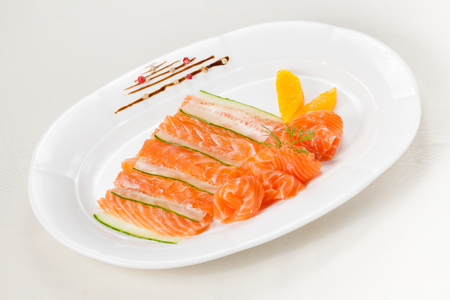 Fresh salmon with orange and cucumber on white background Stock Photo
