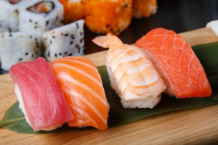 japanes: Japanes food. Assorted Sushi nigiri set on a wooden background Stock Photo