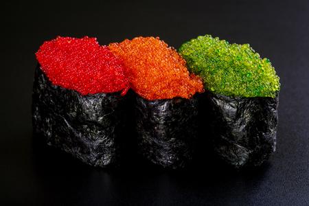 Japanes food. Assorted Sushi gunkan on black background Stock Photo