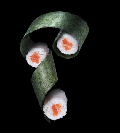oversized: Flying sushi with salmon on a black background. 3 roles Stock Photo