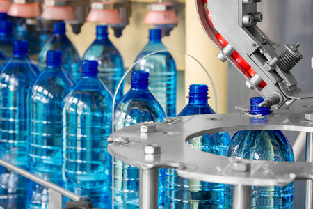 The line at the factory for the production of plastic bottles Stock Photo